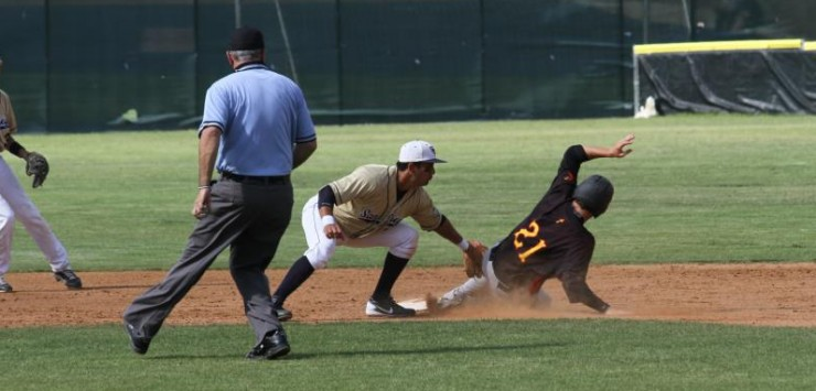 ACU's Seth Neely slides in just ahead of SDCC's Gilbert Viera's tag.